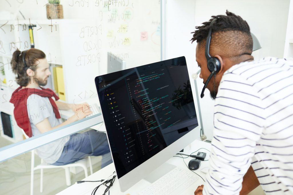 IT support operator answering question using headset